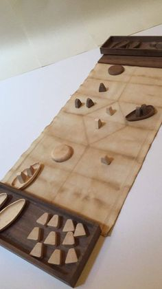 HIRÞ WOOD - Hand made version of HIRÞ, The Viking Game of Royal Conflict.Challenge your friends in this ingenious and portable game, uniquely crafted to gi
