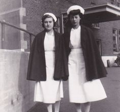 Two 1940s nurses with their capes on - I especially like the rolled bangs on the gal on the right.