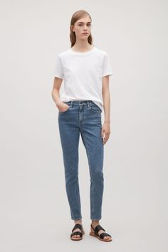 COS image 1 of Skinny-fit cropped jeans in Fresh Blue