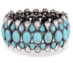 A beautiful turquoise stone stretch bracelet! I'm giving one of these away on my blog today! Stop by and enter to win!  http://www.inspiredbycharm.com/2012/05/i-bought-skateboard-giveaway-day-two.html