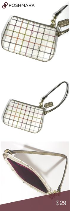 """Coach Tattersall Wristlet Ivory with plaid design and gold strap and hang tag. In excellent pre-loved condition. Measure 7"""" x 4.5"""". Zip top and one credit card slot.  💍Tattersall coated PVC leather  Approx.:  6 1/2"""" (L) x 4 1/2"""" (H). 🔺Questions? Please ask.  🔺I want your Poshmark experience to be easy & enjoyable. 🔺Thank you for shopping at Posh Mishmosh. Coach Bags Clutches & Wristlets"""
