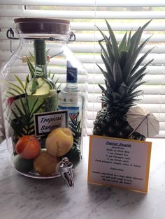 Tropical Sangria gift or for the newlyweds! Ingredients for sangria, some pineapple and coconut chocolate bars, and some tropical leaves. Acrylic dispenser from Crate and Barrel. Alcohol Gift Baskets, Wine Gift Baskets, Alcohol Gifts, Basket Gift, Jar Gifts, Food Gifts, Craft Gifts, Homemade Gift Baskets, Homemade Gifts