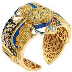 "Having a Cleopatra moment from @mcldesign Gold jewelled Bangle from our ""Pharao Collection"" #mcldesign #matthewcampbelllaurenza #clutchbag #jewellery #diamond #ruby #sapphires #emerald #aquamarine #saksfifthavenue #neimanmarcus #bergdorfgoodman #harrods #fashion #art #artpiece #lanecrawford #jewellery #gemstones"