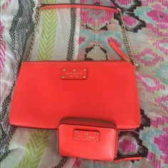 KATE SPADE purse & wallet Beautiful coral Kate Spade Wellesley bad with matching NWT wallet. Purse has been carried once. See pic 4 for minor discoloration on back of the purse. Otherwise in exceptional condition. Wallet is NWT. See pics 3 and 4. The bag is 10.5 inches across. And the strap drop is 8.5 inches. MAKE AN OFFER :) kate spade Bags Shoulder Bags