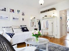 pretty in white decorated small appartment