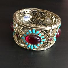 HPstretch bracelet NWOT stretch bracelet definitely more beautiful in person. Gold with red and turquoise stones. HP by beautiful Lorena @loreenacreel  Macy's Jewelry Bracelets