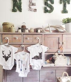 diy stenciled onesies + downloadable template The blogger prepped a bunch of these for a baby shower activity.