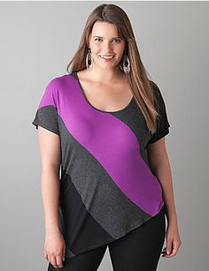 Fashion-forward tunic top embraces today's hottest trend with an asymmetric colorblock motif. Designed to get compliments, this comfortable knit top flatters any body type with a scoop neck, relaxed silhouette and ruched side detail. Tunic length is just right with jeggings, skirts and more for versatile styling.  sonsi.com