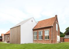 Atelier Tom Vanhee has converted a former school building in Woesten to a community centre and added a white gabled extension to the original brick facade. Cabinet D Architecture, Architecture Old, Amazing Architecture, Architecture Details, Wooden Facade, Brick Facade, Villa, Old Building, School Building