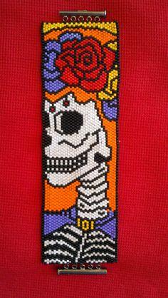 Beadweaving by Bev Berthoty. Peyote stitch.  Delicas. Sugar Skull pattern by Debbie van Tonder.
