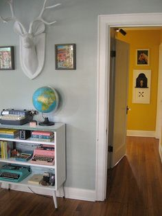 I love the light Blue walls in this room and the mustard in the hall.