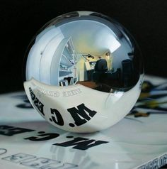 painting of an office reflection through a spherical mirror