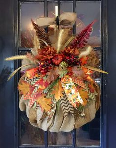 A personal favorite from my Etsy shop https://www.etsy.com/listing/251069469/fall-burlap-pumpkin-wreath