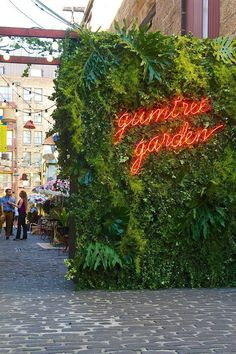 """Gumtree Garden Pop-Up Bar,pinned by Ton van der Veer"" quoted - I friggin love this! The living wall is so lush and wild and then the neon lights burn through with vibrance. Design Exterior, Exterior Signage, Ranch Exterior, Bungalow Exterior, Exterior Stairs, Wall Exterior, Exterior Lighting, Wayfinding Signage, Signage Design"