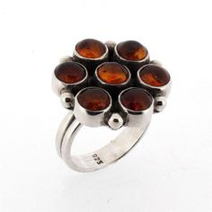 Purple Leopard Boutique - Brown Amber Flower Sterling Silver Ring Cocktail Ring Size 9 Polish Jewelry, $99.00 (http://www.purpleleopardboutique.com/brown-amber-flower-sterling-silver-ring-cocktail-ring-size-9-polish-jewelry/)