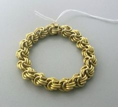 Vintage Tiffany & Co 18k Gold Woven Chain Bracelet  http://hamptonestateauction.com/