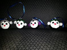 Golf ball penguins Need: black sharpie,  pom poms, pipe cleaner and screw hooks! Super cute and easy