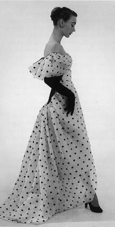 Balenciaga, 1952 Sophie Malgat is wearing an evening dress of white organdy embroidered with black polka-dots.