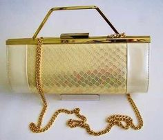 9e17890dc4b Stunning barrel shape 3 way bag for any special occasion in pearlized ivory  with a feature clasp heavy chain