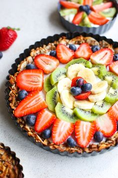 Fruity Granola Breakfast Pizza - a grain free nut & coconut crust that's naturally sweetened with a coconut cream top and fresh fruit | Paleo + Vegan + Gluten Free