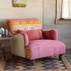 """ISHITA SARI CLUB CHAIR -- Hand chosen by our merchants, vintage khadi cotton saris from India are crafted into limited edition chairs that will become the centerpiece of any room. Patchwork is unique to each chair, finished with a black welt on natural linen sides and back. Bolster pillow included. FSC®-certified maple frame with turned front legs, eight-way hand-tied spring and foam cushioning. Made in USA exclusively for Sundance, so individual that each has a name. 33""""W x 42""""D x 32""""H."""