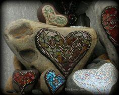 Beautifully painted hearts on rocks.