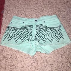 Roxy embroidered Jean short Great condition! Worn maybe 2-3xs. Super cute mint color with black embroidered design on front. I know you want to wear these to Coachella... Roxy Shorts Jean Shorts