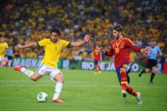 Fred of Brazil shoots as Sergio Ramos of Spain tries to block him during the FIFA Confederations Cup Brazil 2013 Final match between Brazil and Spain at Maracana on June 30, 2013 in Rio de Janeiro, Brazil.