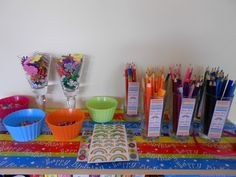 Pens, pencils, foam flowers, stickers and beads all ready for the girls.
