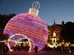 People walk near a giant Christmas ornament display in Nice, France.   Valery Hache, AFP/Getty Images