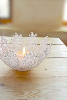 Doily Snowflake Bowl  •  Free tutorial with pictures on how to make a fabric storage bowl in under 60 minutes #howto #tutorial