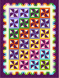 Pin Wheel Quilt in Solids and a border that has few peers.  Very appealing.