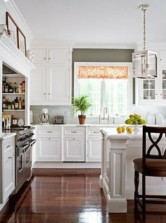 Love this - a white kitchen with a dark floor