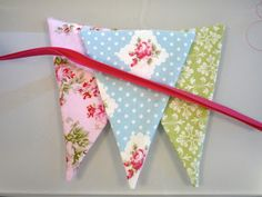 Today I finished my first homemade fabric bunting and I've learned a few things along the way.  So here are a few tips and observations ...