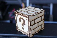 Mario question block 3D puzzle is an AWESOME addition to your gaming decor! Made to order by a frickin laser!  Orders of 5 or more come with a free sixth block!  Dimensions: Card: 4 x 6 Finished Block: 1.5 x 1.5 x 1.5