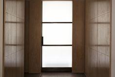 Dressing room and bespoke full height blackened steel sliding door. Interior designed by Teresa Hastings 2010.
