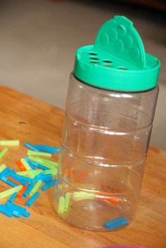 These grated cheese containers are awesome for fine motor play with small objects!