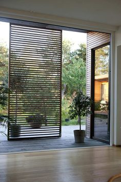 Slats are also a wonderful addition to outdoor spaces. The wood, of course, is a natural fit while the slat design allows air to circulate while still blocking a lot of sun, keeping spaces cool and comfortable even in the summer.