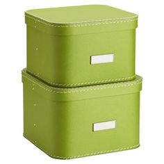 """Green Oskar Boxes. 11"""" sq. x 7-1/2"""" h. •Constructed from heavyweight 90% post-consumer recycled fiberboard •100% recyclable •Integrated label holders •Designed to fit 12"""" and 16"""" elfa Shelves •Exclusive to The Container Store"""