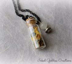 Witch Bottles have been used for hundreds of years for protection and spells. This Divination Witch Bottle Amulet Necklace from Inked Goddess Creations contains herbs and gemstones to help open your t