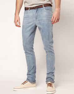 light wash jeans and off white shoes