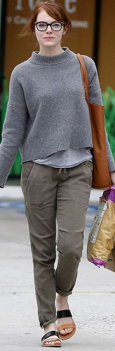 Who made Emma Stone's black glasses, green pants, gray sweater, and tan flat sandals?