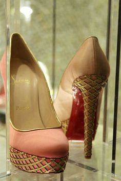 pink and gold Louboutin high heel pumps