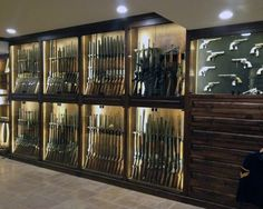 Discover the top 100 best gun room designs featuring cool armories you'll want to acquire. Explore traditional cabinetry to modern shelving security. Weapon Storage, Gun Storage, Gun Safe Room, Gun Closet, Closet Safe, Reloading Room, Gun Vault, Trophy Rooms, Modern Shelving