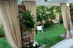 """Use canvas painters drop clothes for an inexpensive """"Outdoor curtain"""". I might try this to block the evening sun on the patio. She has so many decorating/cleaning ideas."""