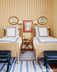 Stripes galore for the young boys' bedroom: Phillip Jeffries's Island Raffia wallcovering, Matouk bed linens, and Dash & Albert rugs.