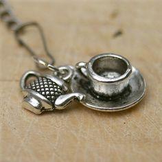 Mesh tea ball with tea cup and tea pot charms.