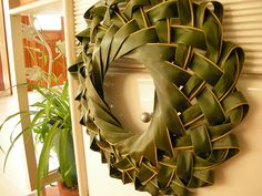 Palm Wreath - Being Catholic we celebrate Palm Sunday where we receive palms and sometimes we weave them into crosses and this wreath would be such a neat craft idea to do for Palm Sunday.