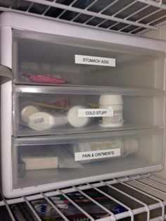 Use labeled storage drawer organizers to organize medications {featured on Home Storage Solutions 101}