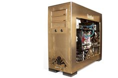 The 24K-gold-plated PC shown at left. Yes, the $21,150 Voodoo Omen PC's precious case stood out when it was unveiled in 2008, but beyond the bling, that water-cooled beast absolutely screamed performance. Voodoo, Locker Storage, Beast, Desktop, Bling, Water, Gold, Home Decor, Gripe Water